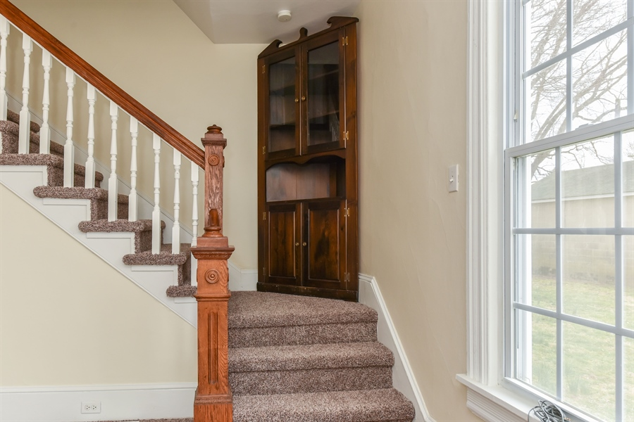 Real Estate Photography - 176 Main St, Warwick, MD, 21912 - 3 corner cupboard on landing is included