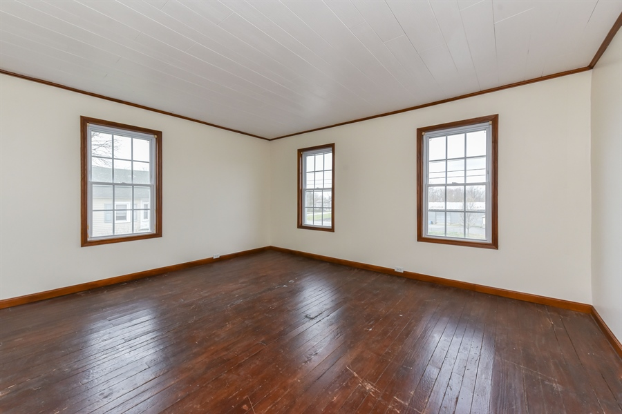 Real Estate Photography - 176 Main St, Warwick, MD, 21912 - 15x13, front bedroom, hardwoods in need of love