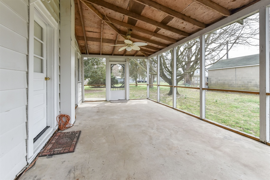 Real Estate Photography - 176 Main St, Warwick, MD, 21912 - This porch has hosted some fun times & crab feasts