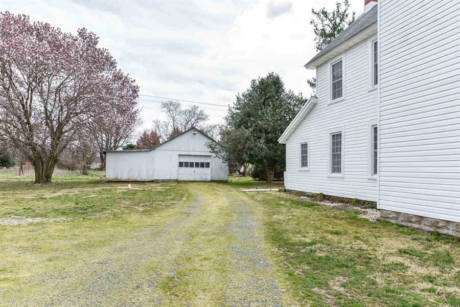 Real Estate Photography - 176 Main St, Warwick, MD, 21912 - The detached garage also has a side run-in shed