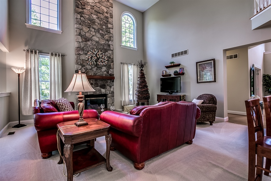 Real Estate Photography - 131 Viburnum Dr, Kennett Square, PA, 19348 - Fabulous Family Room With A Stone Fireplace