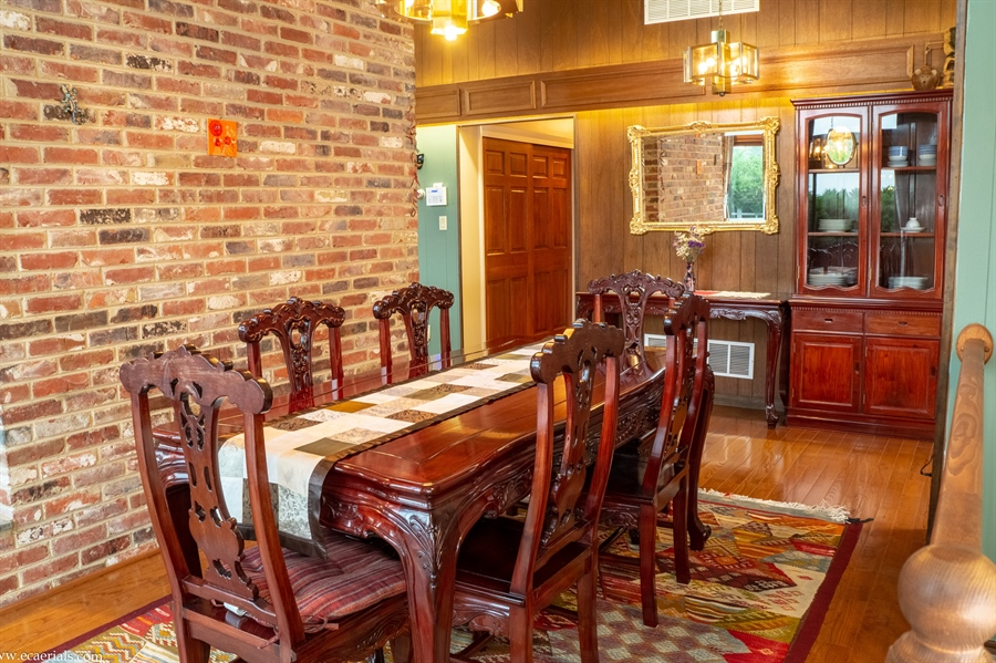 Real Estate Photography - 25 N Rosemont Cir, Elkton, MD, 21921 - DINING ROOM brick wall to ceiling