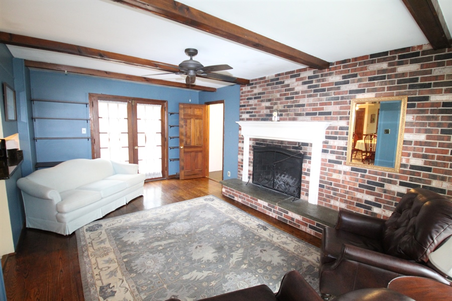 Real Estate Photography - 321 E 14th St, New Castle, DE, 19720 - Family room with wood burning fireplace