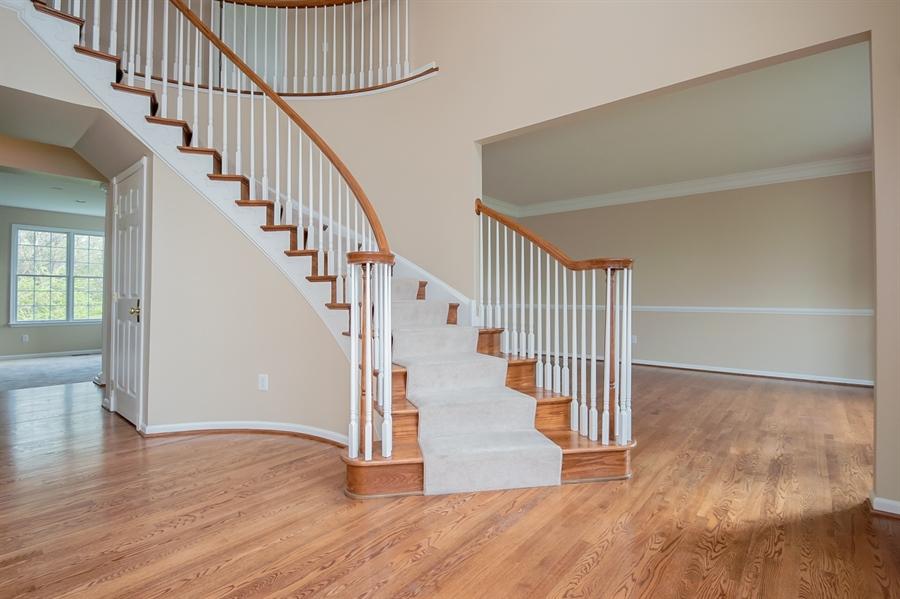 Real Estate Photography - 420 Nattull Dr, Bear, DE, 19701 - Grand Oak Two-Story Turned Staircase