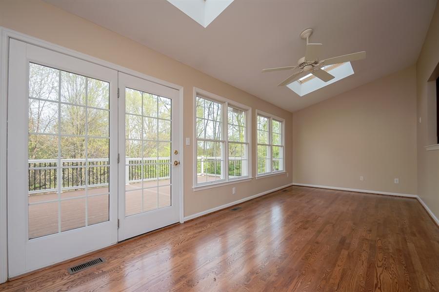 Real Estate Photography - 420 Nattull Dr, Bear, DE, 19701 - Sun Room w/Ceiling Fan & Patio Door to Trex Deck