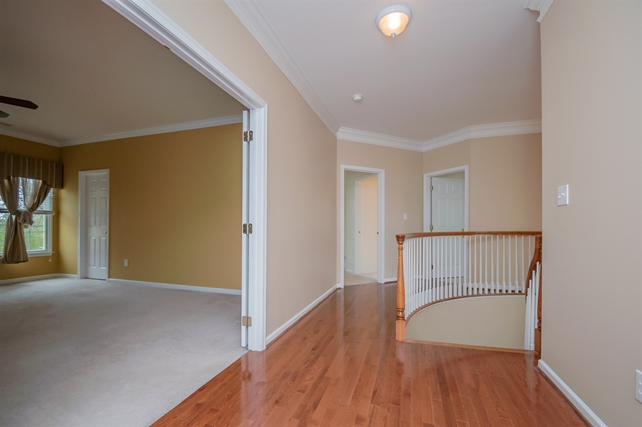 Real Estate Photography - 420 Nattull Dr, Bear, DE, 19701 - Upstairs Hallway with Back Staircase