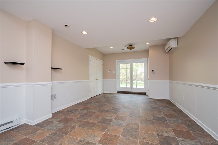 Real Estate Photography - 420 Nattull Dr, Bear, DE, 19701 - Finished Basement w/Kitchenette & Door to Patio