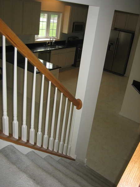 Real Estate Photography - 28 Oklahoma State Dr, Newark, DE, 19713 - Back staircase to kitchen