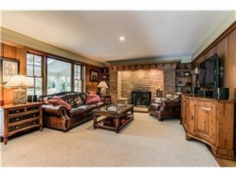 Real Estate Photography - 103 Brookmeadow Rd, Greenville, DE, 19807 - Family Room with Large Stone Fireplace