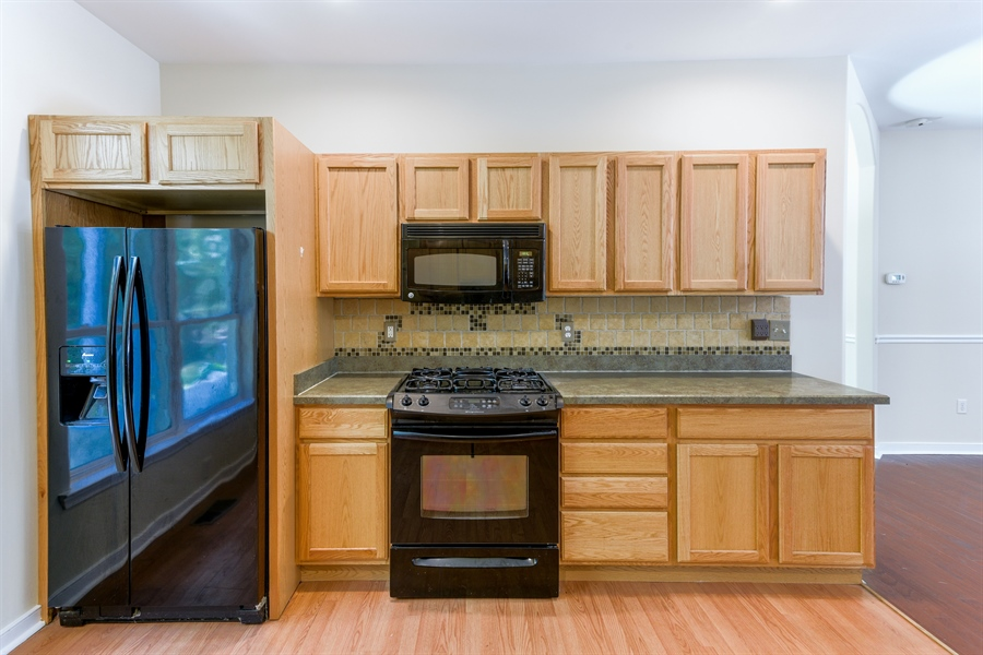 Real Estate Photography - 20835 Bull Pine Rd, Georgetown, DE, 19947 - Kitchen w/Gas Stove