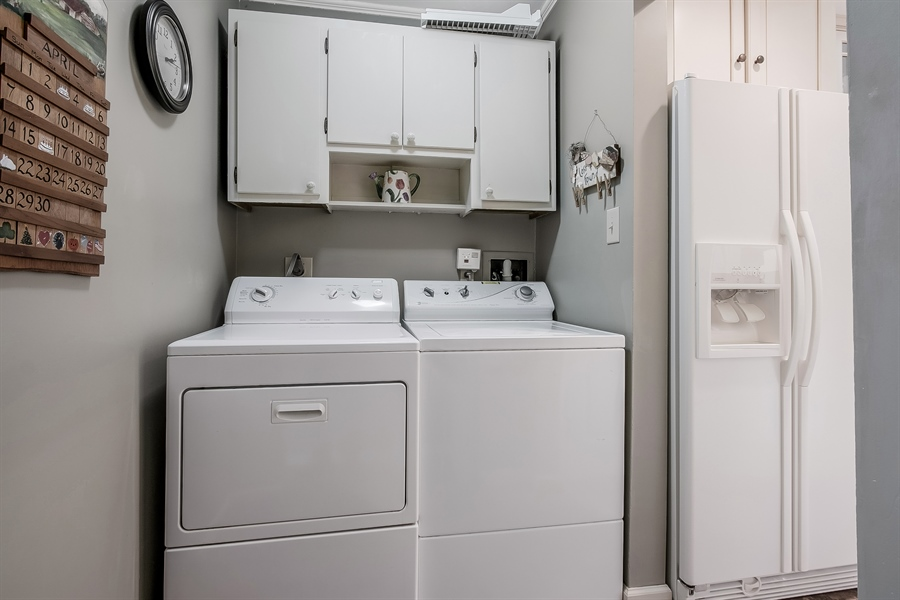 Real Estate Photography - 220 Stonecrop Rd, Wilmington, DE, 19810 - First Floor Laundry Room With Cabinets