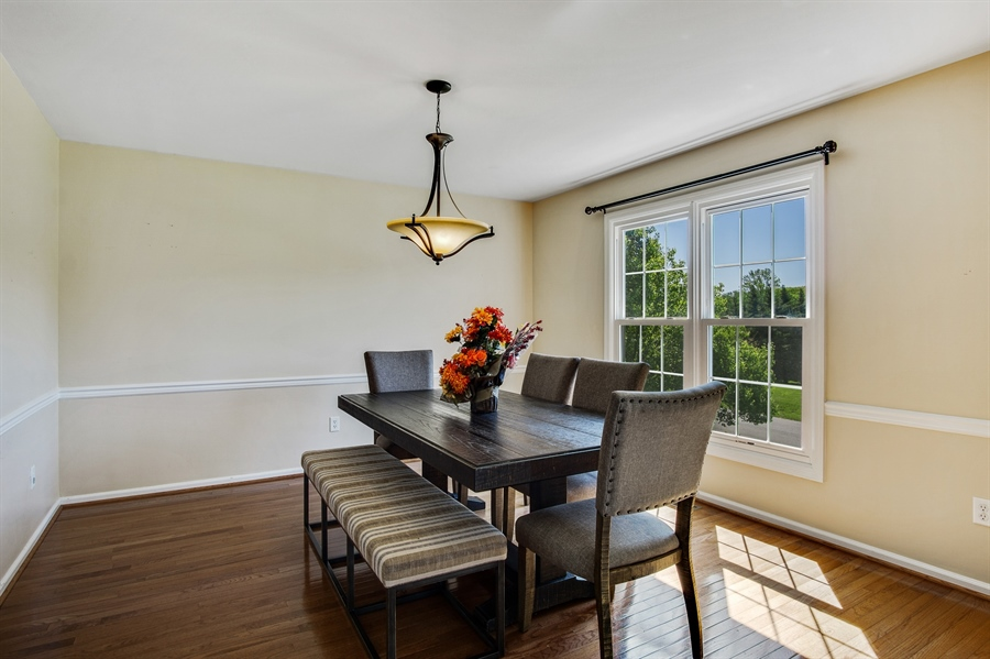 Real Estate Photography - 104 Yorkshire Ct, Middletown, DE, 19709 - Dining room with chair rail