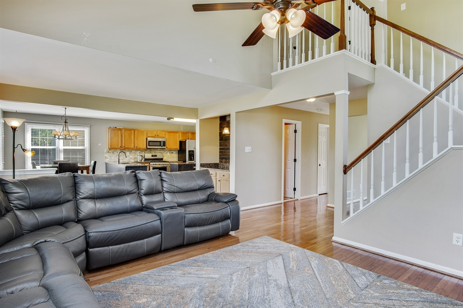 Real Estate Photography - 104 Yorkshire Ct, Middletown, DE, 19709 - Staircase with landing overlooking family room
