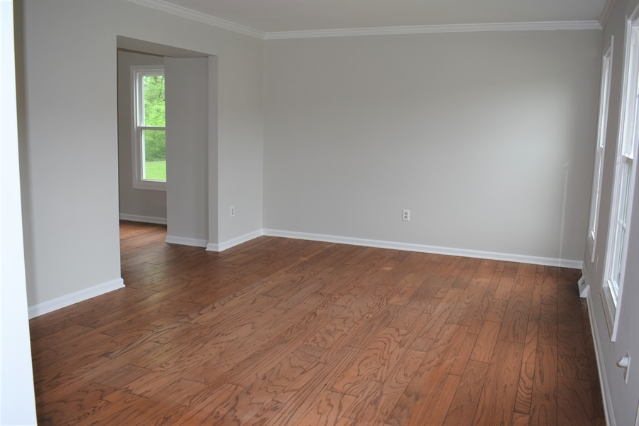 Real Estate Photography - 121 Brandywine Dr, Dover, DE, 19904 - Formal living room with hardwood floors.
