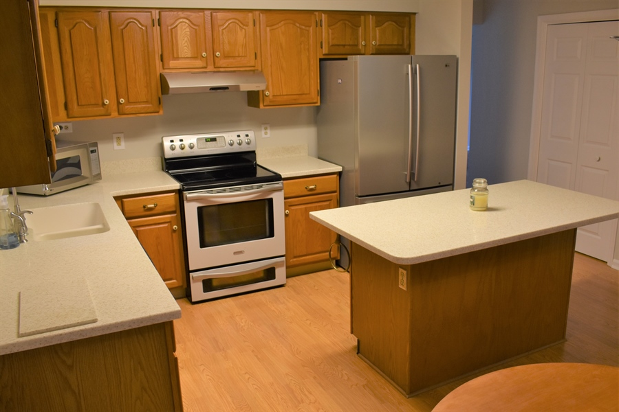 Real Estate Photography - 121 Brandywine Dr, Dover, DE, 19904 - Corian countertops with integrated sink