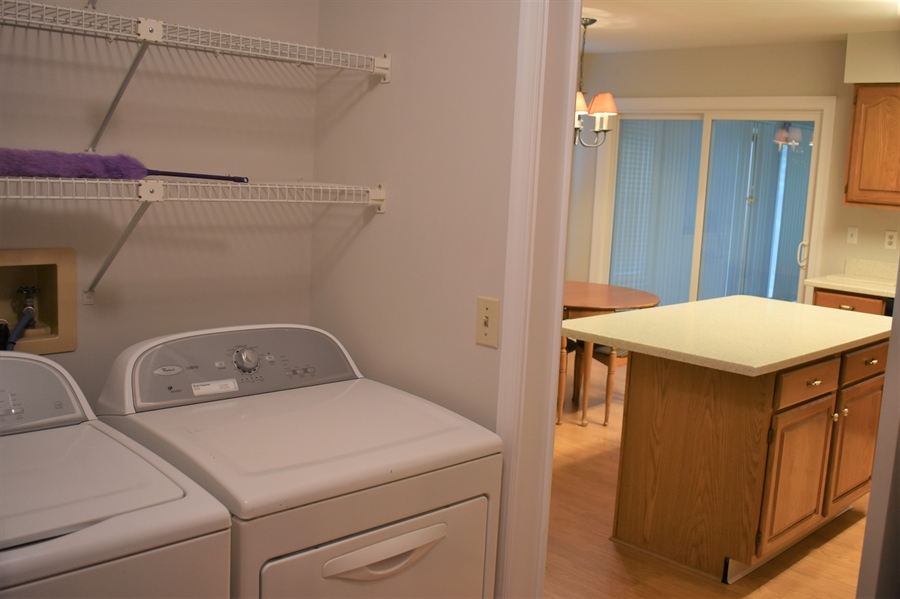 Real Estate Photography - 121 Brandywine Dr, Dover, DE, 19904 - Main floor laundry conveniently off the kitchen