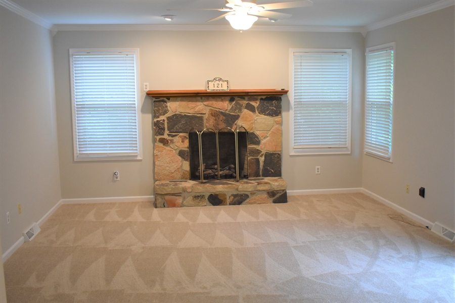 Real Estate Photography - 121 Brandywine Dr, Dover, DE, 19904 - Step down family room with gas fireplace