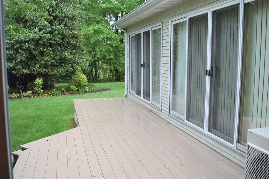 Real Estate Photography - 121 Brandywine Dr, Dover, DE, 19904 - One of two maintenance free decks