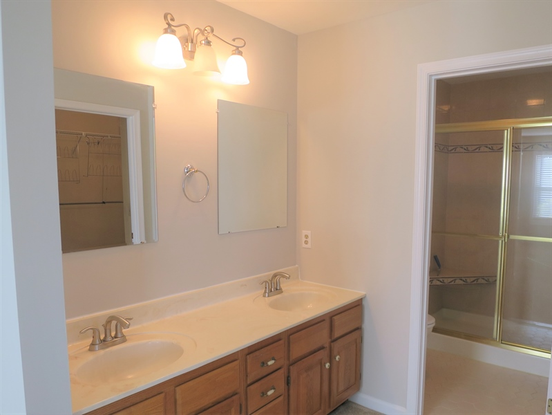 Real Estate Photography - 121 Brandywine Dr, Dover, DE, 19904 - Double vanity and tile shower