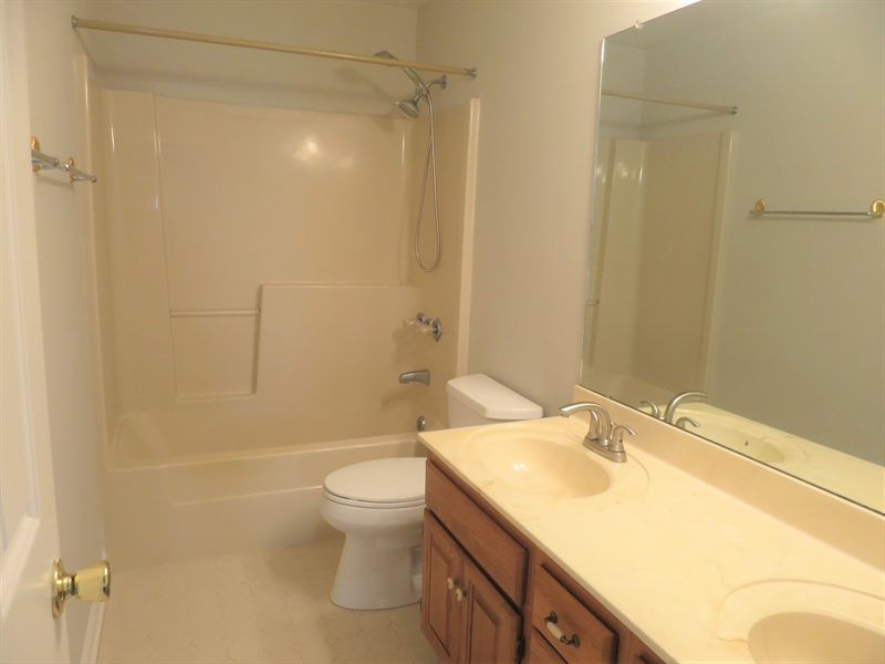 Real Estate Photography - 121 Brandywine Dr, Dover, DE, 19904 - Upstairs full bath with double vanity