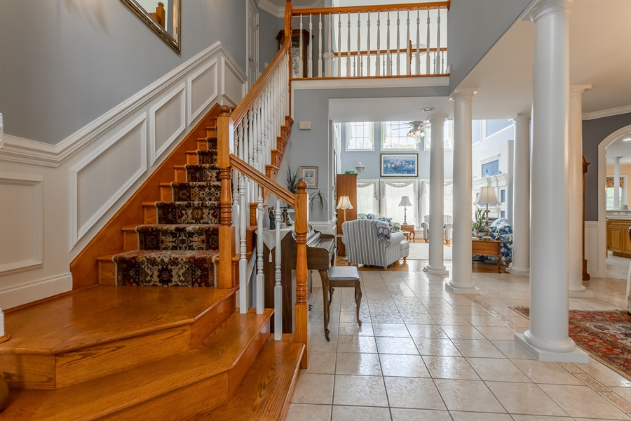 Real Estate Photography - 2 Plantation Ct, Ocean View, DE, 19970 - FOYER, STAIRWAY TO 2ND FLOOR AND LIVING ROOM