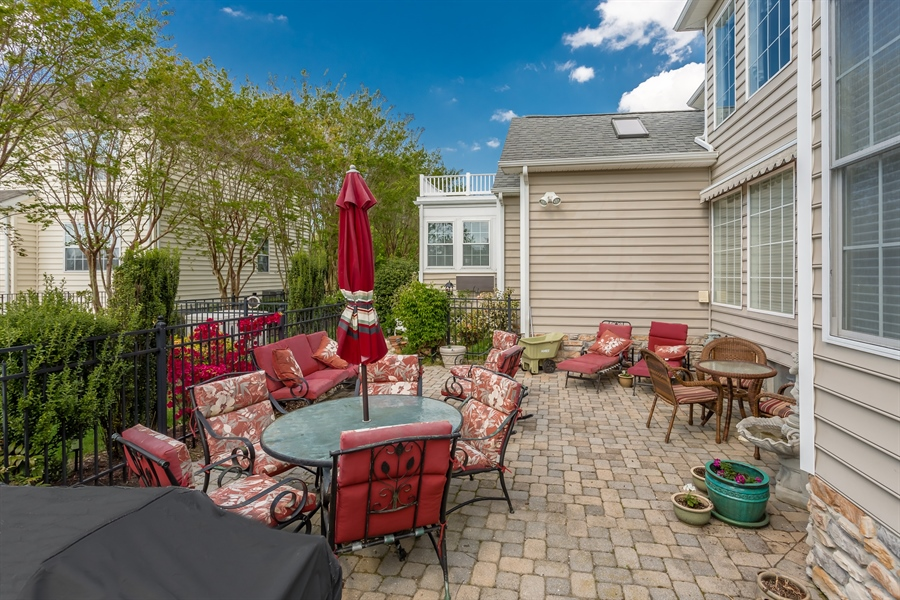Real Estate Photography - 2 Plantation Ct, Ocean View, DE, 19970 - PAVER PATIO FOR ENJOYING WARM SUMMER EVENINGS!