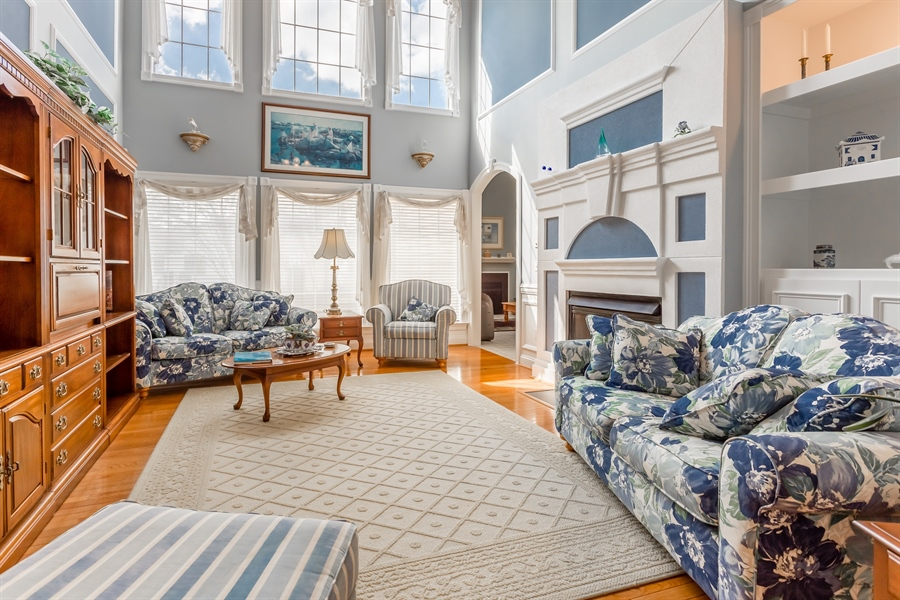 Real Estate Photography - 2 Plantation Ct, Ocean View, DE, 19970 - LIVING ROOM WITH LOADS OF WINDOWS & GAS FIREPLACE