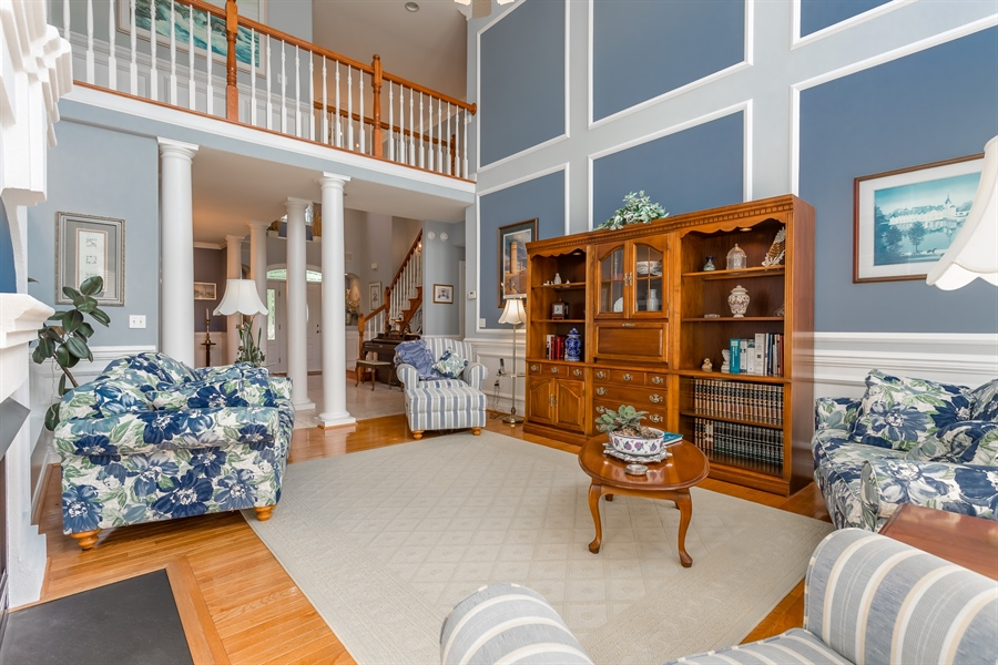 Real Estate Photography - 2 Plantation Ct, Ocean View, DE, 19970 - LIVING ROOM WITH GAS FIREPLACE AND 2 STORY CEILING