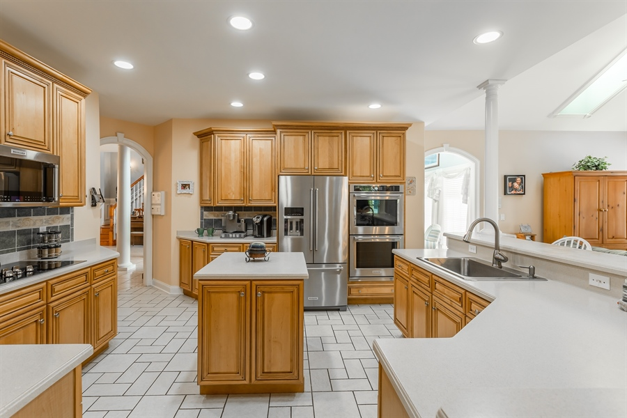 Real Estate Photography - 2 Plantation Ct, Ocean View, DE, 19970 - HUGE KITCHEN W/CORIAN COUNTERS AND CENTER ISLAND