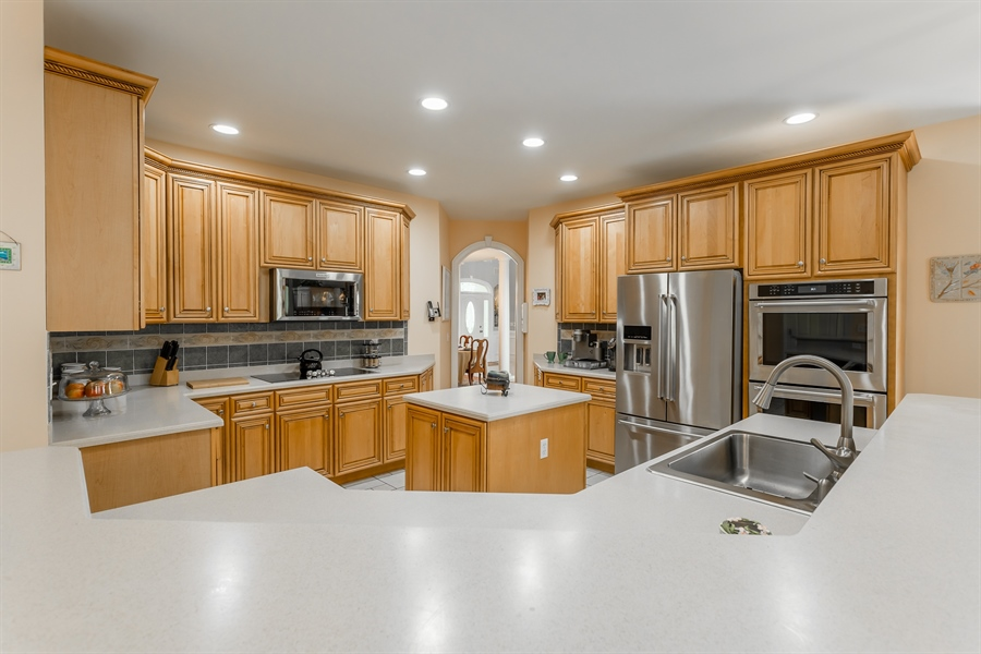 Real Estate Photography - 2 Plantation Ct, Ocean View, DE, 19970 - HUGE KITCHEN WITH CENTER ISLAND AND BREAKFAST BAR