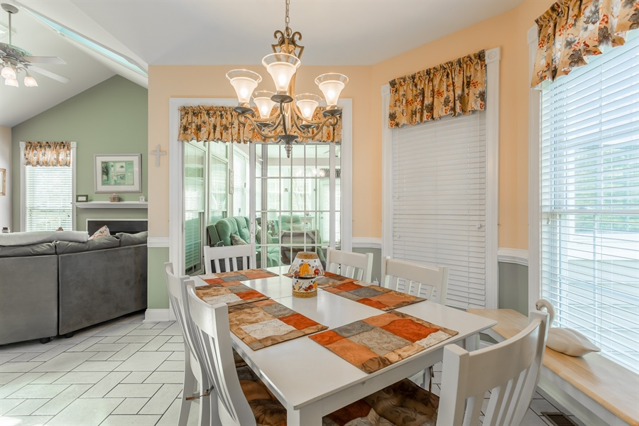 Real Estate Photography - 2 Plantation Ct, Ocean View, DE, 19970 - DINING AREA, FOUR SEASON ROOM AND FAMILY ROOM