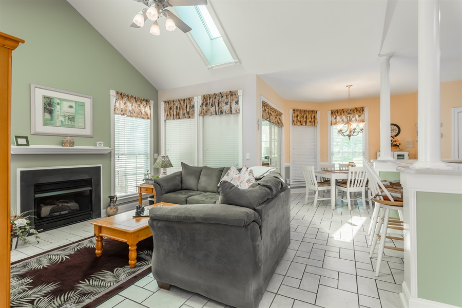 Real Estate Photography - 2 Plantation Ct, Ocean View, DE, 19970 - COZY FAMILY ROOM WITH GAS FIREPLACE