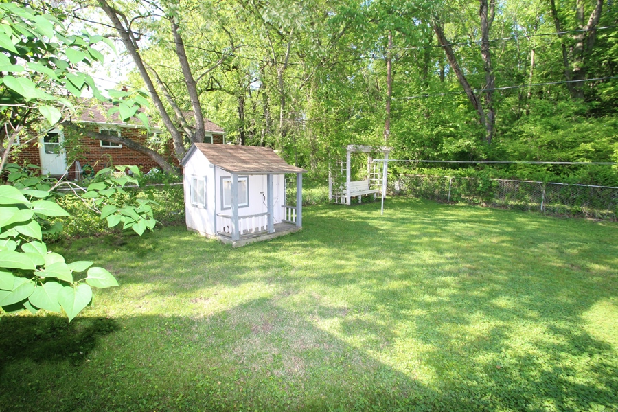 Real Estate Photography - 33 Ridge Dr, New Castle, DE, 19720 - Fenced Rear Yard with Playhouse