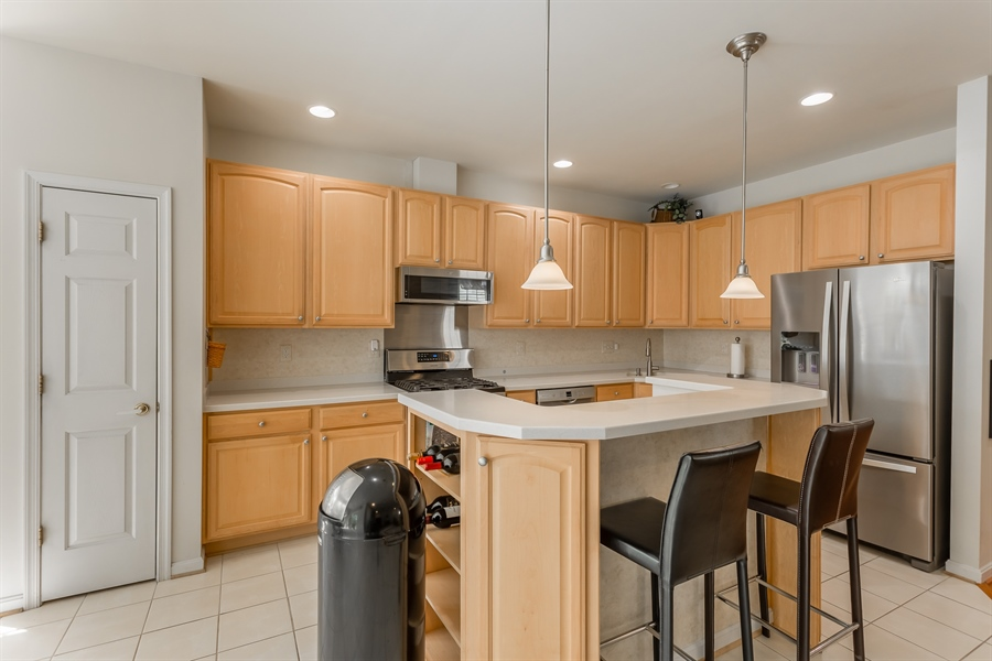 Real Estate Photography - 101 Emilys Pintail Dr, Bridgeville, DE, 19933 - KITCHEN WITH ISLAND AND UPGRADED COUNTER TOPS