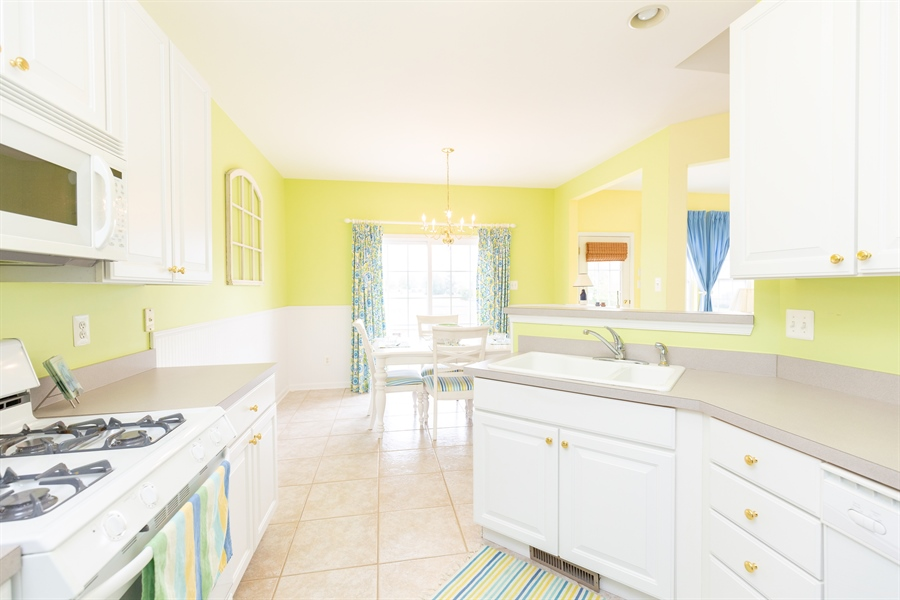 Real Estate Photography - 14 Wauwinet Ct, Rehoboth Beach, DE, 19971 - Light & Bright Kitchen