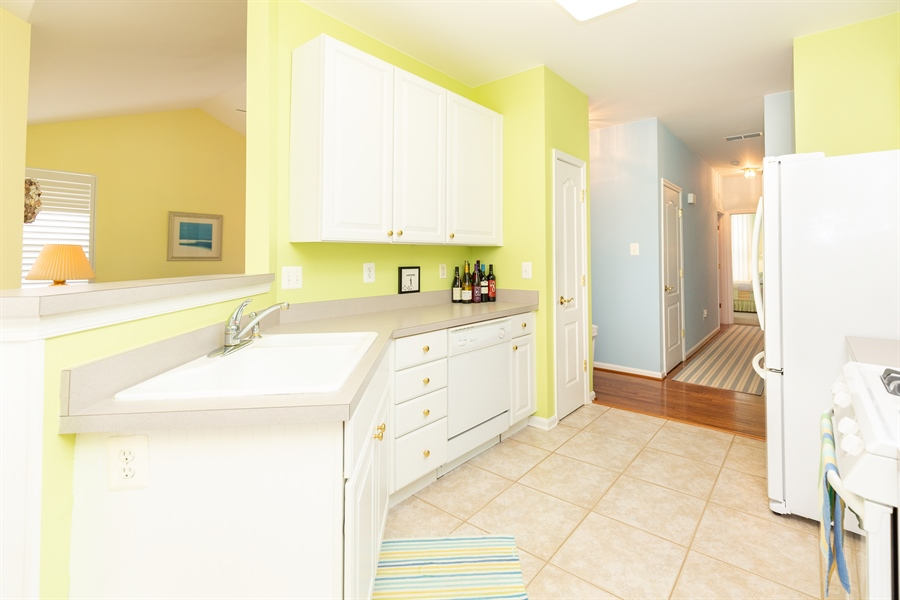 Real Estate Photography - 14 Wauwinet Ct, Rehoboth Beach, DE, 19971 - Kitchen Open to Living and Dining Rooms
