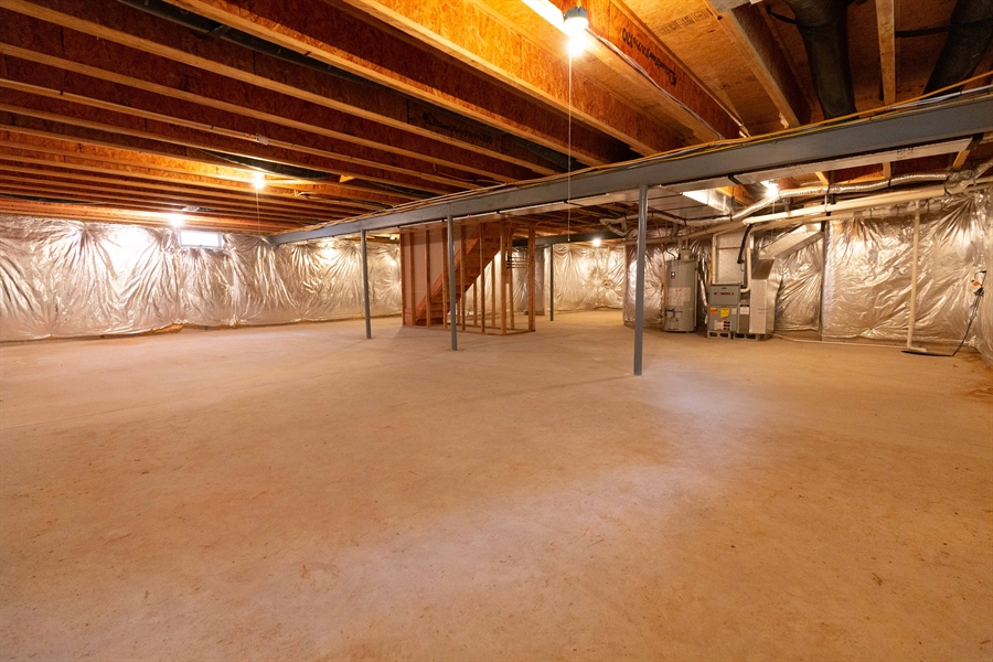 Real Estate Photography - 14 Wauwinet Ct, Rehoboth Beach, DE, 19971 - Unfinished Full Basement