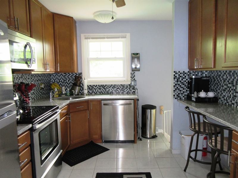 Real Estate Photography - 13 Cook Rd, Newark, DE, 19711 - Full View of Kitchen from Center Hallway