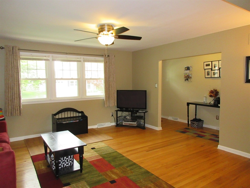 Real Estate Photography - 13 Cook Rd, Newark, DE, 19711 - Family Room View Towards Hallway Entr-Ceiling Fan