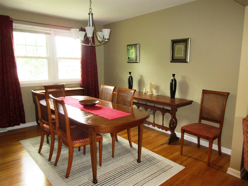Real Estate Photography - 13 Cook Rd, Newark, DE, 19711 - Nice Size Dining Room-Hardwoods-Chandelier