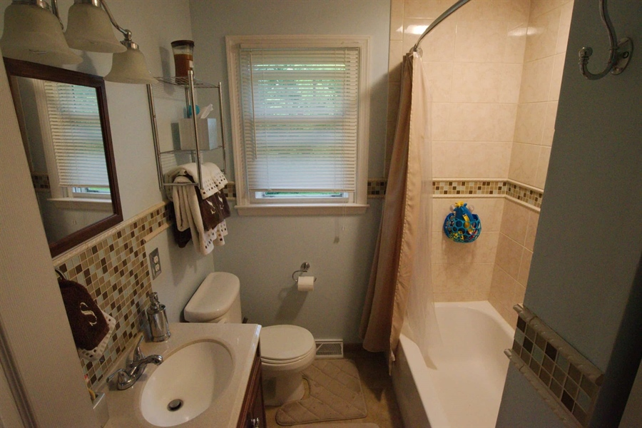 Real Estate Photography - 13 Cook Rd, Newark, DE, 19711 - Fully Updated Main Floor Bathroom