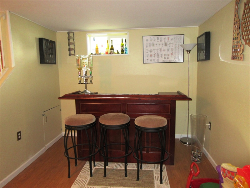 Real Estate Photography - 13 Cook Rd, Newark, DE, 19711 - Bar area a 10' x 9' Extension Finished Basement Rm
