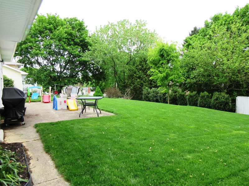 Real Estate Photography - 13 Cook Rd, Newark, DE, 19711 - Beautiful Backyard w Cement Patio for Entertaining