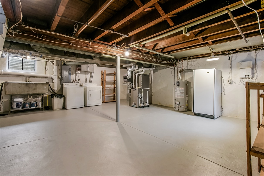 Real Estate Photography - 2606 Cleveland Ave, Claymont, DE, 19703 - Unfinished basement with loads of storage space