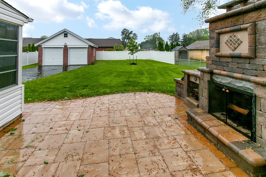 Real Estate Photography - 2606 Cleveland Ave, Claymont, DE, 19703 - Fabulous patio with outdoor fireplace!