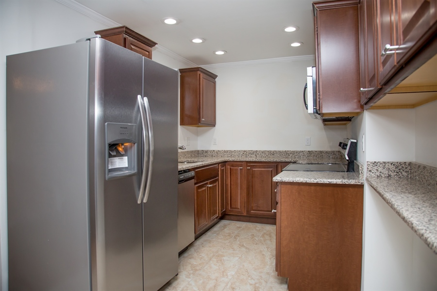 Real Estate Photography - 9 Brookland Ave, Wilmington, DE, 19805 - Granite kitchen with stainless steel appliances!
