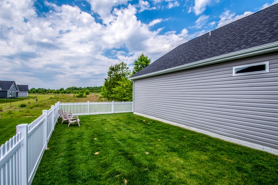 Real Estate Photography - 29717 Riverstone Drive, Milton, DE, 19968 - Fenced Yard