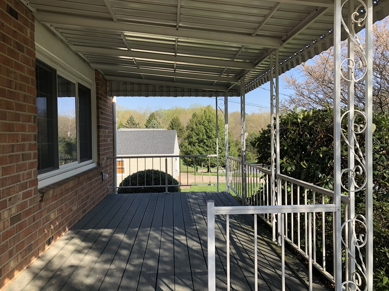 Real Estate Photography - 702 W Church Rd, Newark, DE, 19711 - Relaxing covered front porch
