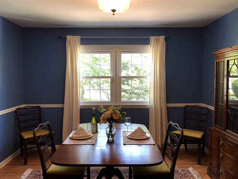 Real Estate Photography - 702 W Church Rd, Newark, DE, 19711 - Dining Room with hardwoods and chair rail