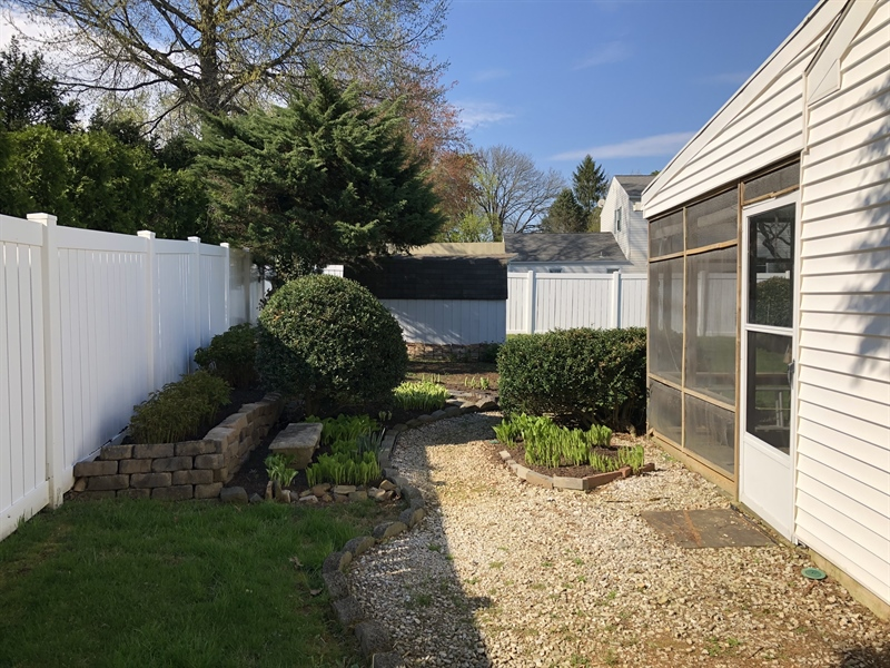 Real Estate Photography - 702 W Church Rd, Newark, DE, 19711 - ...leads to walkway, storage shed, & private yard